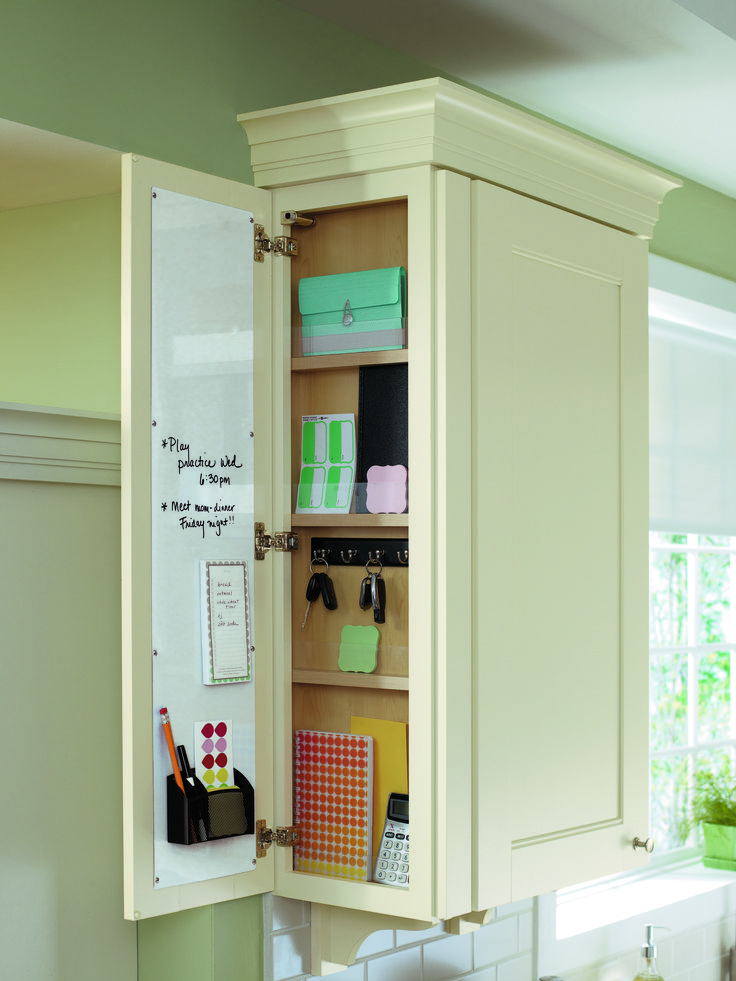 Stay organized with this ingenious message center, hidden right in your kitchen cabinet. I like the idea of hiding it too...