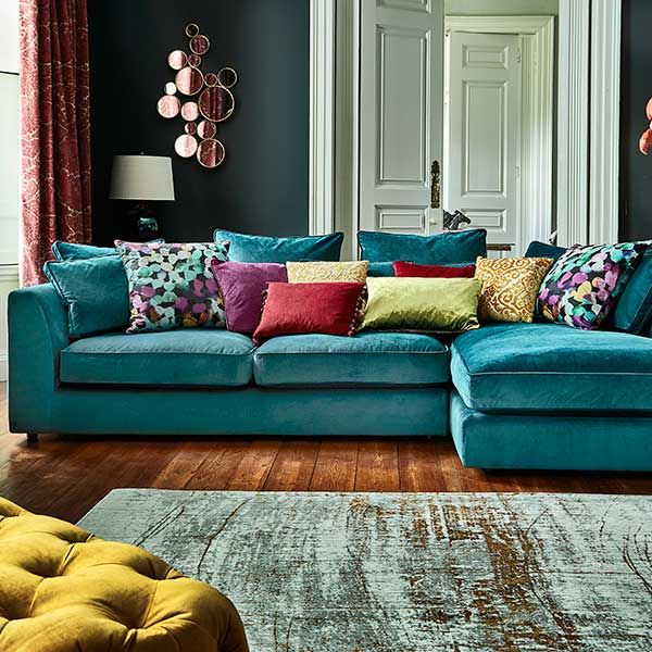 The striking Harrington Large Chaise sofa is a fantastic addition to a home looking for something a little different. The jewelled lumino teal colour will add a bold look to your home.