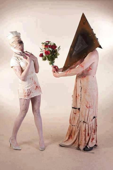 Nurse and Pyramid Head (from Silent Hill 2) cosplay. This is so wrong, and I love it.