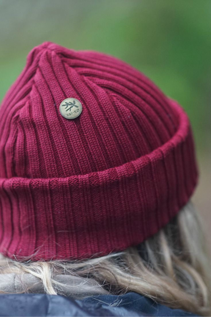 Red burgundy merino wool beanie by VAI-KO. Outdoor outfit, hipster hiking look. Metal button beanie. Photo and model @secretagentmike & @lindseynaglieri