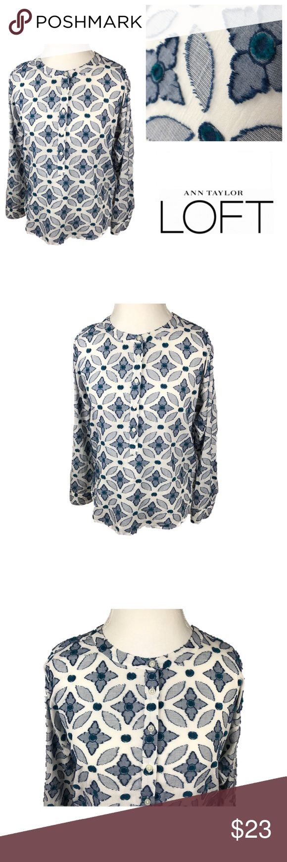 Ann Taylor LOFT Floral Long Sleeve Top. Floral Long Sleeve Top. The softened shirt has a relaxed fit with 5 buttons going down half the front and one at each cuff. Lovely textured look giving the shirt dimension.  Gently worn. Fabric does have mild wear including pulls off thread and small areas missing thread. Due to the busy design this does not take away from the quality of the shirt. See last picture.  Blue & white Small 100% cotton  Approximate measurements in inches  Shoulder 20 Sleeve…