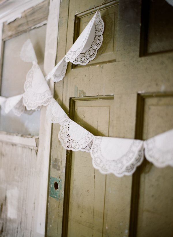 white paper doilies - great for a wedding or shower. Hang behind or around the cake table