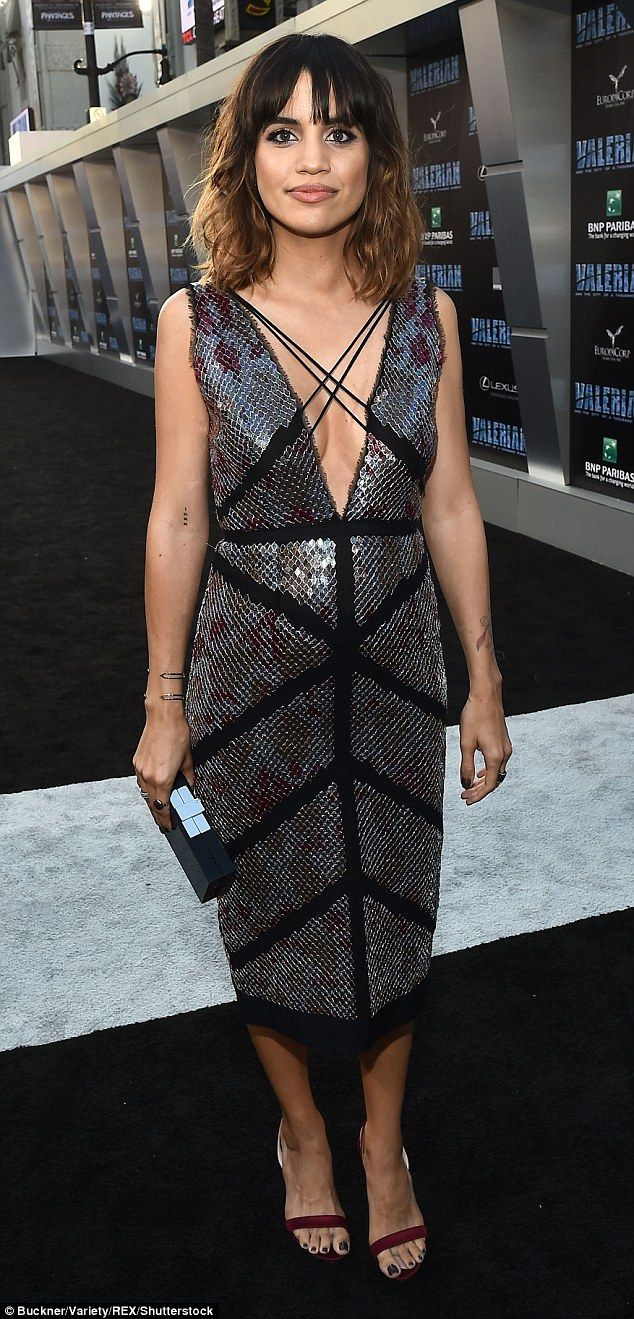 Natalie Morales wore a sleeveless sequinned dress with bold black lines and criss-cross la...