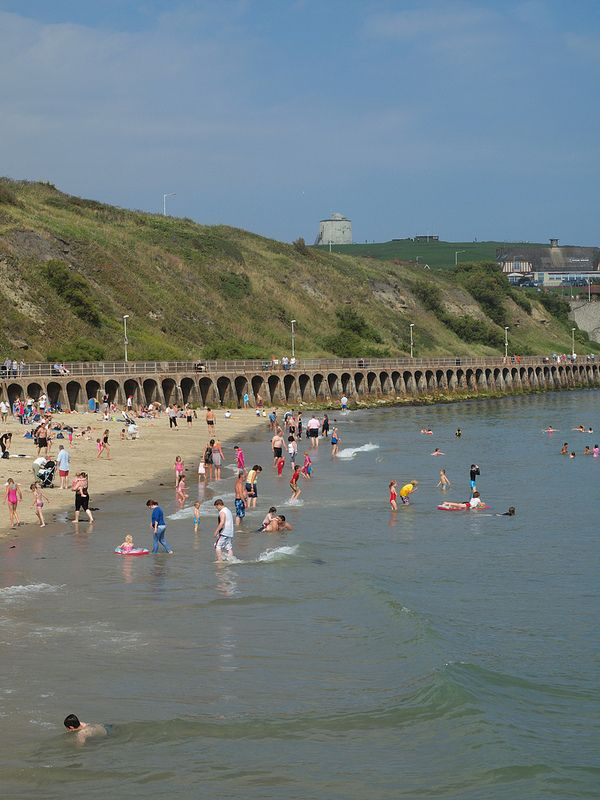 Sea bathing off Sunny sands beach Folkestone , Kent [shared]