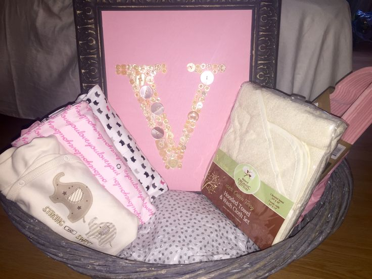 Baby shower DIY basket. Here is how I used the frame to decorate the basket filled with a few other goodies. I used decorative tissue paper to fill the bottom to raise the gifts. Basket from Michael's.