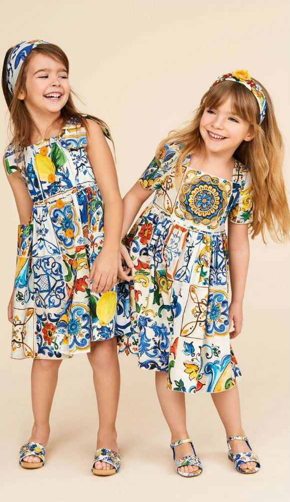 ae57e60de2b1 Love! Girls beautiful Majolica print dress by Dolce & Gabbana for Summer  2018. The cool cotton poplin is printed with a Sicilian ceramic tile print.