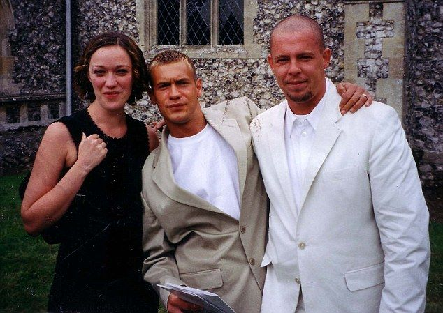 Alexander McQueen, right, with ex-husband George Forsyth and his sister Belle at a 2001 w...