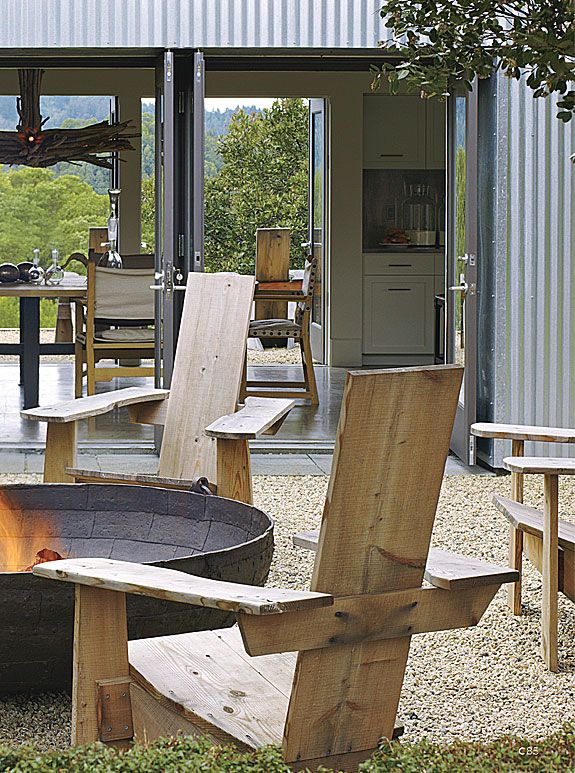 fire pit and modern adirondack chairs / Erin Martin (I'd rather have the traditional Adirondack chairs, but I love the space!)