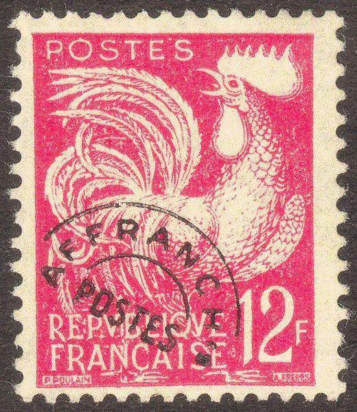 Zoom sur le timbre «Coq Gaulois 12F rouge carminé »