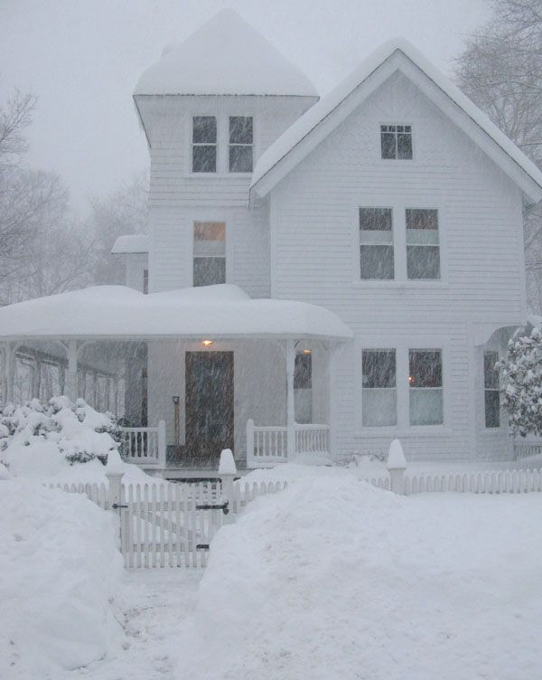 White farmhouse in the snow