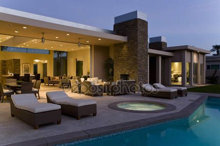 Download - House exterior with sunloungers on patio — Stock Image #34008939