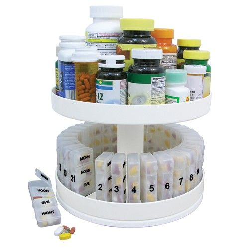 """Revolving Medicine Center with 31Daily Pill Compartments -   10"""" diameter. Complete with 31 Separate Pill. Compartments For Every Day Of The Month. Rotates to keep meds at your fingertips. Bottom Tier holds 31 pill holders with 4 separate compartments for morning, noon, evening, & bedtime meds. Top Tier holds all your pill and medicine bottles."""