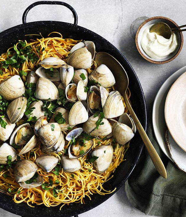 Fideuà is similar to paella (the dishes share a Valencian origin) but made with pasta in place of rice. It's typically made with short, thin noodles known as fideos, but we've used broken-up spaghettini.