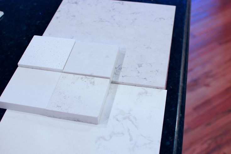 Bottom big one is Cambria Torquay (my fave), top is Cambria Waverton. Of the little ones, bottom right is Zodiaq Bianca Carrera, top right is ceasarstone misty carrera. Bottom left is ceasarstone snow white, top left is ceasarstone cloud white. For Kitchen counter