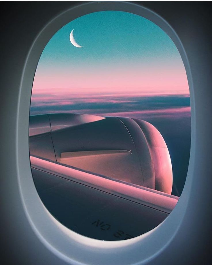 Best view: window sea in a plane, sky and moon high on feelings.