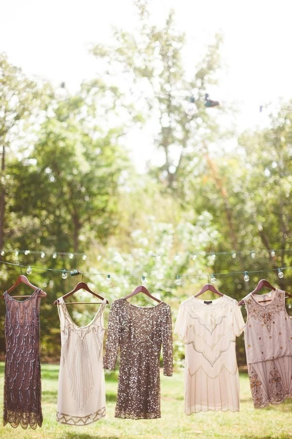 Some wedding themes naturally dictate a bridal party's style. Add dazzle to your Art Deco event by encouraging your friends to find 1920's inspired dresses, with intricate beading or sheer panels in neutral shades. Even if some dresses are deep silver and others are pale peach, they will all naturally coordinate because of their shared style.