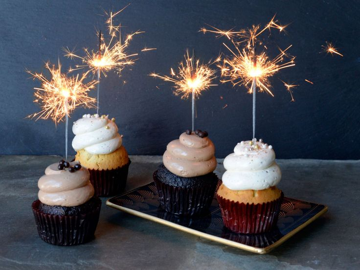 Sparkler Cupcakes : Make any New Year's dessert extra special with the addition of sparkler candles. Cupcakes work especially well, as everyone can have their own personal dessert, with no utensils necessary! Just bake in advance and then light the sparklers when it's time to welcome the sweet new year.