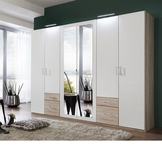 Front alpine white, carcase and application light oak finish bedroom wardrobe in a luxury finish with a contemporary look. The combination of white and mirror a look of elegance and sophistication....