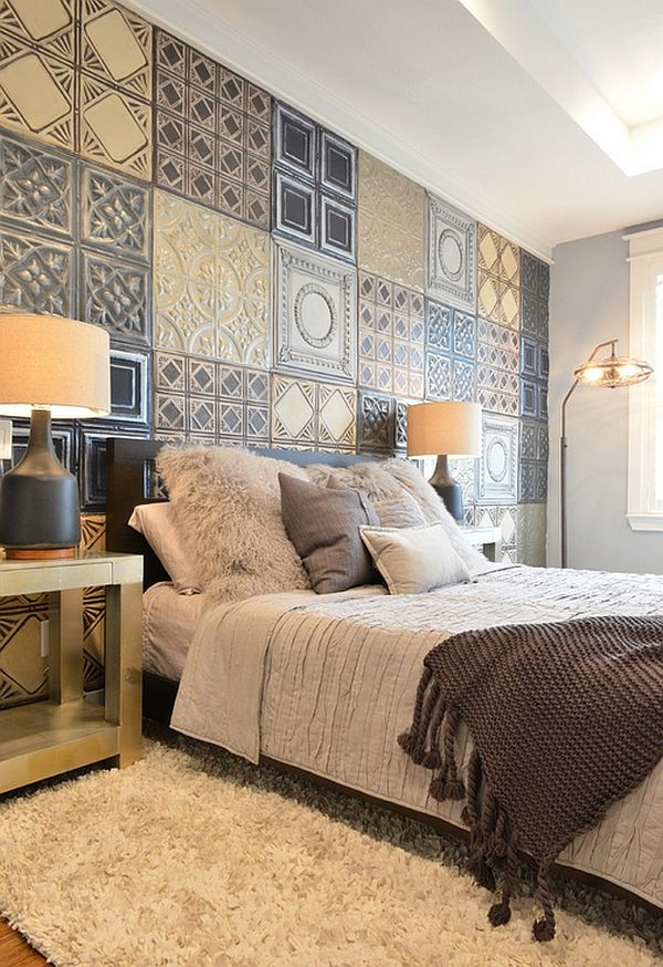 Tin tiles that have been faux painted to make an inimitable backdrop. Love the bedding too