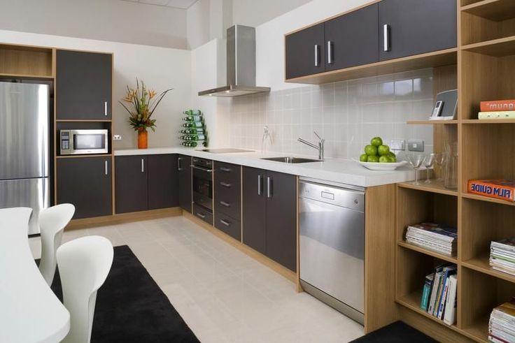KITCHEN - Open plan, simple lines, lots of storage, dishwasher, fridge, small oven, bookshelves in Te Aro (Wellington, NZ)