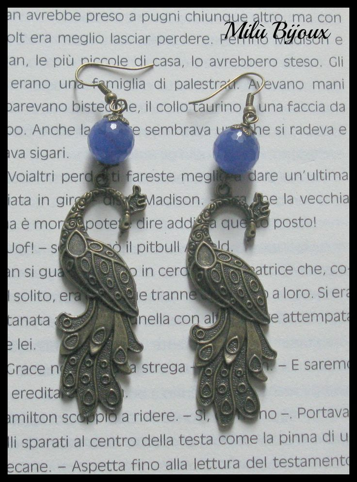 Bronze peacocks with blue agate