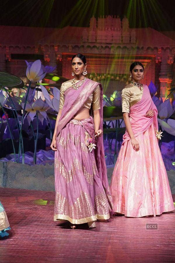 Models showcase creations by Shravan Kumar during 'An Ode To Weaves and Weavers' show at Hyderabad International Convention Centre on June 22, 2016