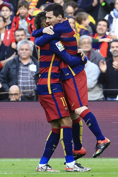 Barcelona's Argentinian forward Lionel Messi (R) celebrates with Barcelona's Brazilian forward Neymar after scoring during the Spanish league football match FC Barcelona vs Club Atletico de Madrid at the Camp Nou stadium in Barcelona on January 30, 2016.