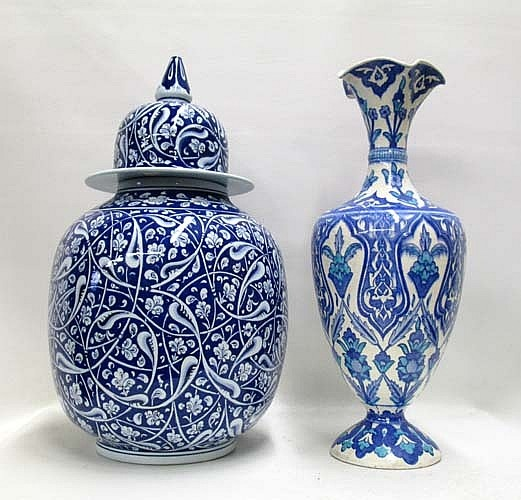 "TURKISH IZNIK POTTERY COVERED JAR AND VASE, 2 pieces, each hand enameled, in shades of blue and white; the covered jar, signed, 18""H; and vase, 16.75""H."