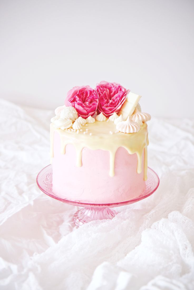 Ginger Malted Vanilla and Hibiscus Cake | ginger malted vanilla cake + hibiscus italian meringue buttercream + white chocolate ganache glaze + meringues, pink sugar pearls, and coconutty rafaello truffles | cake decoration | valentine's