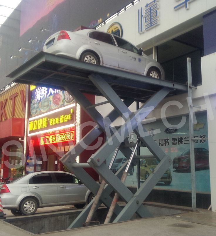 Car scissor lift can transport cars vertically to different levels. Used in basement, station or backyard for parking cars in public buildings or at home. (http://sinolifter.com/stationary-scissor-lift/car-scissor-lift-2500kg.html)