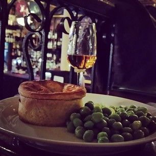 Whisky, pie, and peas at The Pot Still.   21 Delicious Pub Lunches To Eat In Glasgow Right Now
