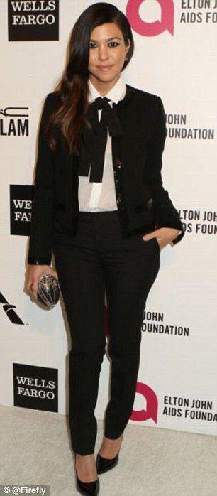 Tux trend: Kourtney Kardashian (left) and Ellen Degeneres have been rocking this trend sin...