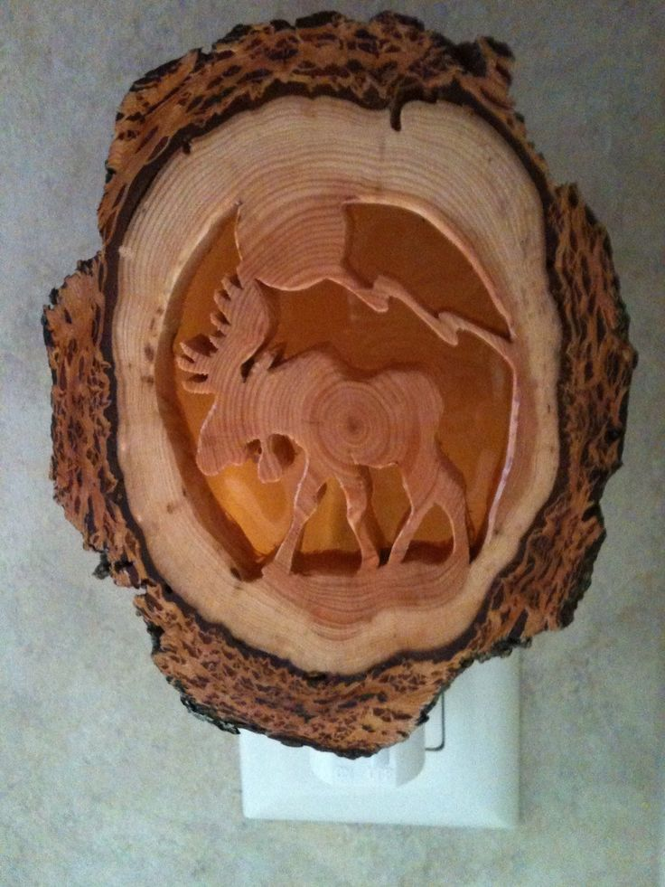 Moose sighting! This night light is hand-made from Douglas fir wood using a scroll saw and an amber colored plastic sheet diffuser. No two night lights are the same as the natural rings in the wood ar