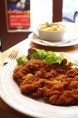 Austria: Wiener Schnitzel, a traditional Austrian dish made with boneless meat thinned with a mallet (escalope-style preparation), and fried with a coating of flour, egg, and breadcrumbs