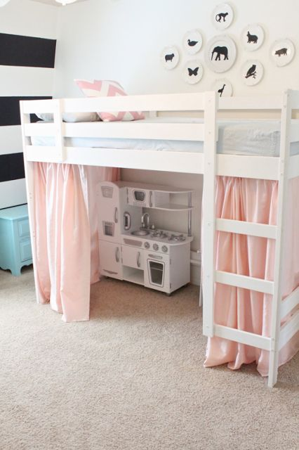 Plain Ikea bunk turned beautiful loft bed! I love all the touched and the feminine pink and blue contrasting with the black and white!