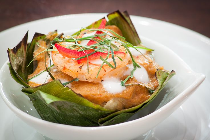 Hor Mok - steamed fish cake seasoned with red curry, topped with shrimp and kaffir lime leaves