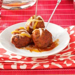 Enchilada Meatballs Recipe -Before I retired, these tasty little treats were popular during snack time at work. They're a good way to use up leftover corn bread. —Mearl Harris, West Plains, Missouri