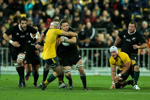 Richie Mccaw Photos Photos - Richie McCaw of New Zealand is tackled by Stephen Moore of Australia during The Rugby Championship Bledisloe Cup match between the New Zealand All Blacks and the Australian Wallabies at Westpac Stadium on August 24, 2013 in Wellington, New Zealand. - New Zealand v Australia - The Rugby Championship