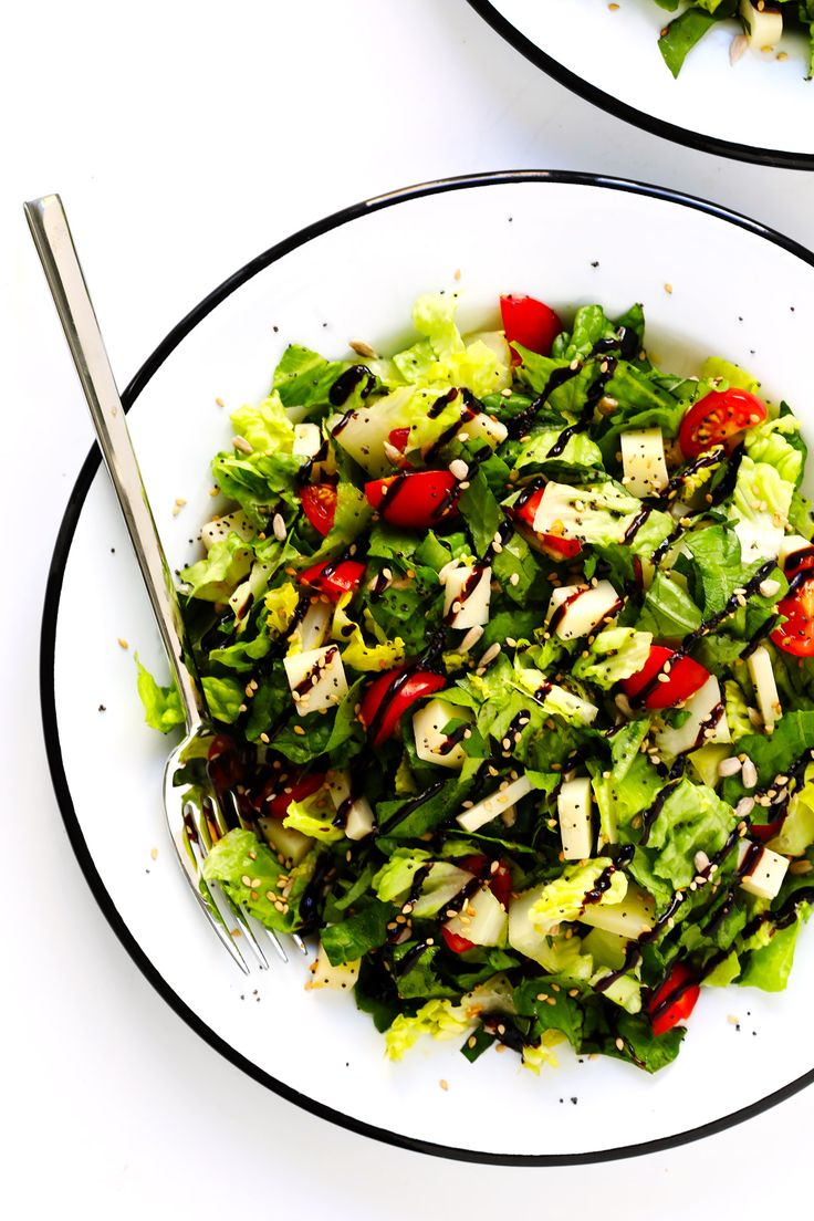 This unforgettable Italian chopped salad is made with lots of tomatoes, fresh basil, Pecorino cheese, Romaine lettuce, balsamic drizzle. And a surprise topping -- everything bagel seasoning!   Gimme Some Oven #salad #italian #choppedsalad #caprese #balsamic