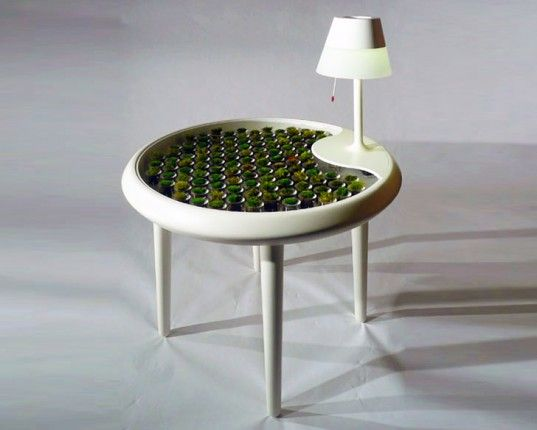 Biophotovoltaic moss table generates electricity through photosynthesis.