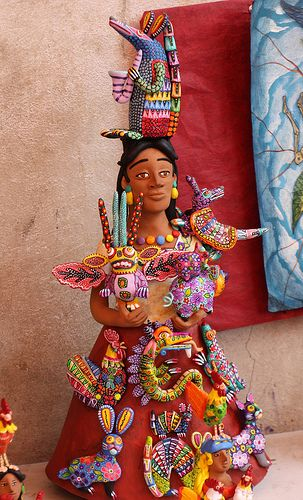 Clay woman covered with Alebrijes (the famous whimsical Oaxacan carved and painted animal figures) by Josefina Aguilar, Ocotlan, Oaxaca, Mexico