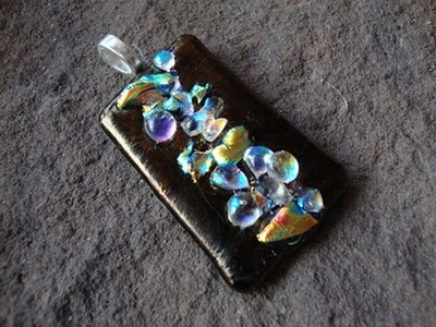 """""""Hytop"""" - This fused glass pendant is one I made with dichroic glass pieces. """"Dichro"""" is often defined as glass having multiple micro-layers of metal oxides which gives the glass a wide range of optical effects. It measures about 1-3/4"""" long and about 1-1/4"""" wide. I'll send a 16""""-18"""" black flocked/velvety cord along so it may be worn immediately.  $50.  Deep Fried Kudzu - DFK Jewelry Designs"""