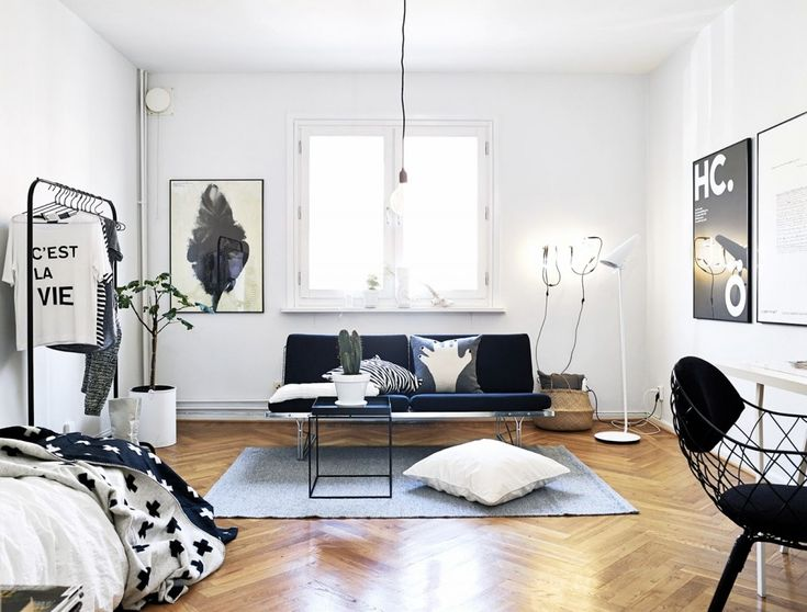This stripped-back stylish space is super minimal and fuss-free, thanks to a few pieces that work together seamlessly. The IKEA Turbo Clothing Rack looks so great in this space with its clean lines. Be sure to invest in a cool Hay side table for a chic accent that sets the room.