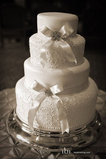 Lace and Bows Wedding Cake. It would be so pretty if the bow was purple                                                                                                                                                                                 More