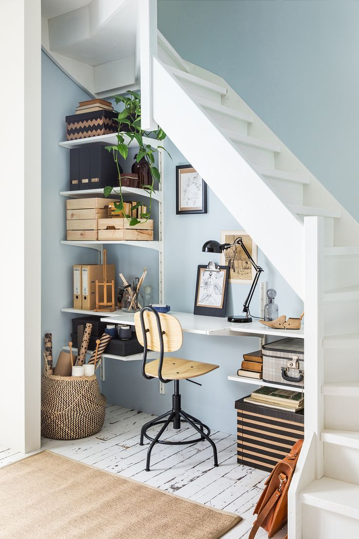Workspace under the stairs with blue walls by IKEA