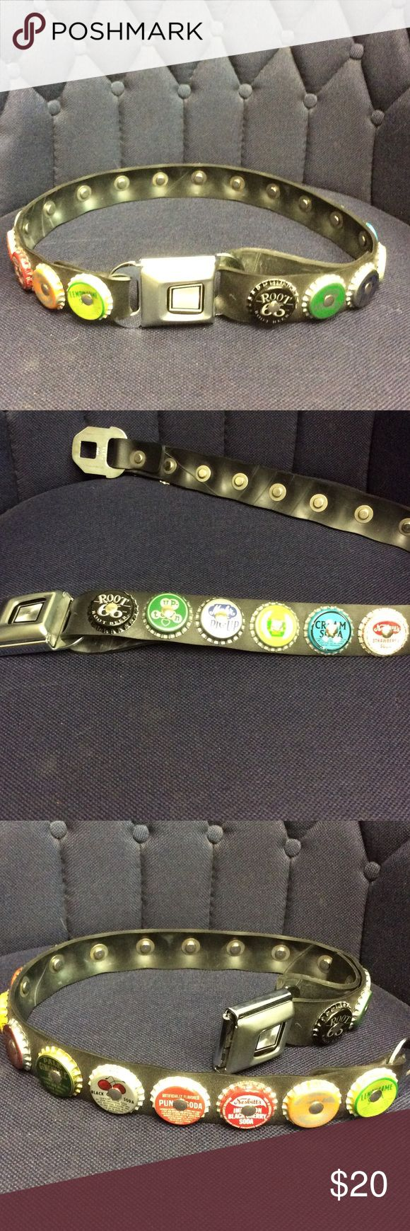 Awesome Pop Bottle Rubber Seatbelt Clasp Belt NWOT - This is an awesome black rubber belt with a real automobile seat belt buckle as a clasp. There are three interior snaps to adjust the belts size. Fits a 30-33 inch waist.  Bundle for a discount. Accessories Belts