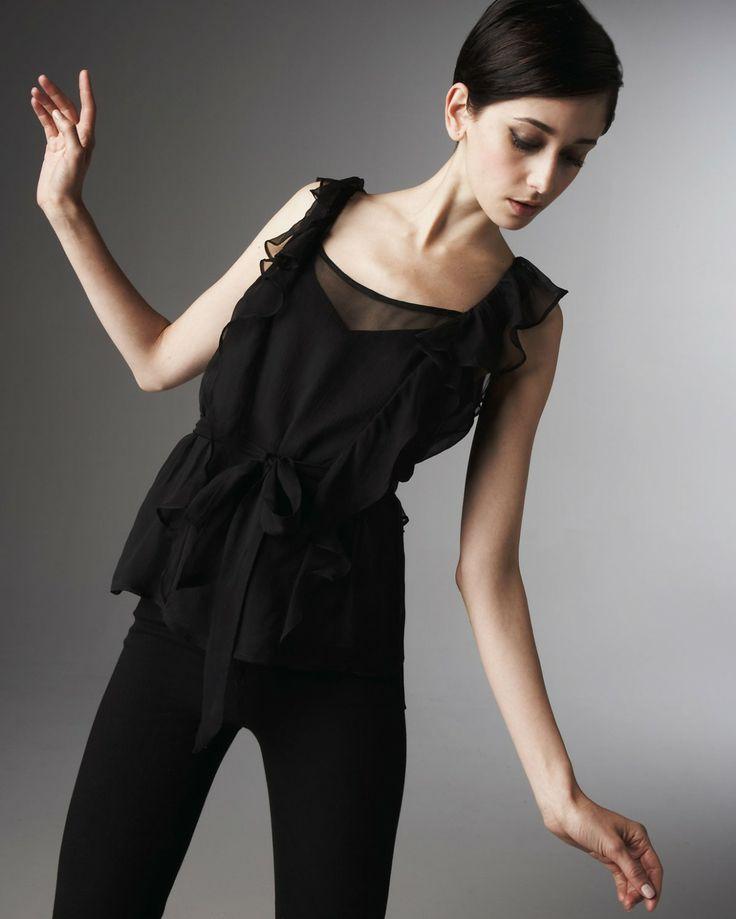 Cecilia Mendez - short dark hair - black outfit