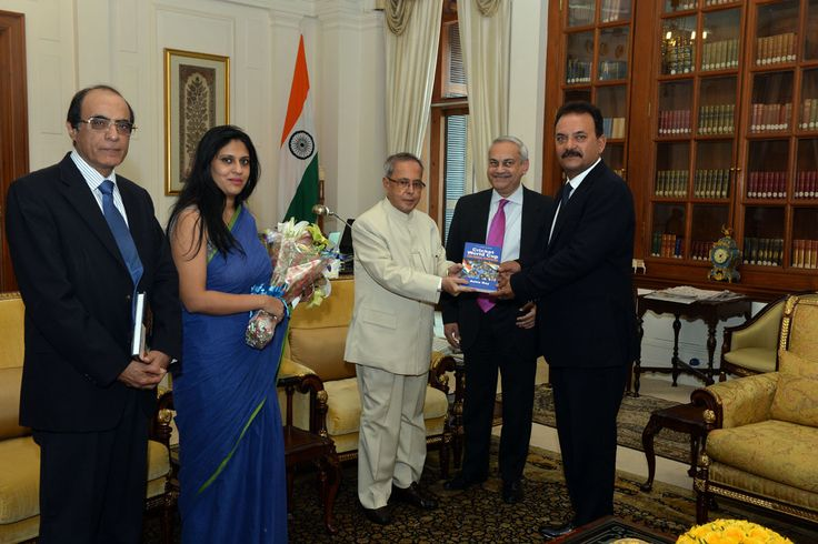 Pranab Mukherjee, the President of India, officially releasing the book CRICKET WORLD CUP by Ashis Ray (middle), at Rashtrapati Bhavan (President's House)