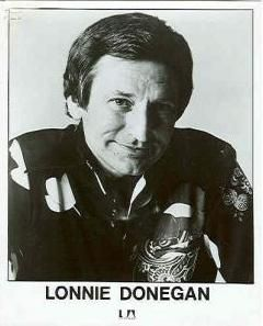 "Lonnie Donegan (1931 - 2002) Scottish-born guitarist and singer. Song hits include ""Rock Island Line"" and ""Does Your Chewing Gum Lose Its Flavor (On the Bedpost Overnight)?"""