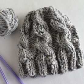 Free pattern for a chunky cable knit hat that is really easy and quick to make. Perfect for gifts!